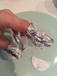 Wrapping fingers with cotton pads and aluminum foil